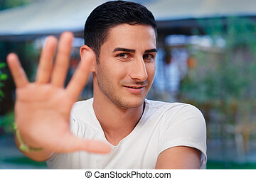 Man Rising Hand Making Stop Gesture - Portrait of a handsome...