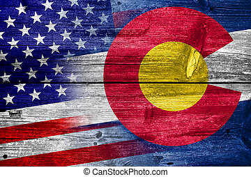 USA and Colorado State Flag painted on old wood plank...