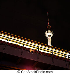train and tv tower in berlin by night