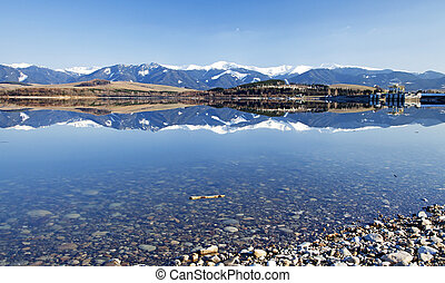 Water landscape - Low Tatras mountains and water reflection...