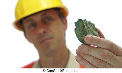 Miner Inspects Copper Carbonate Ore - Short depth of field...