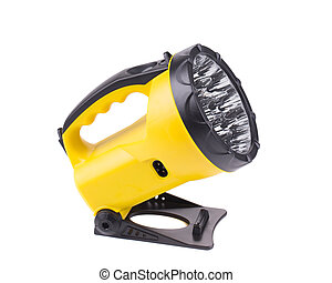 Yellow flashlight isolated on white background in closeup
