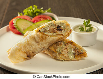 Traditional roll kebab paratha tikka wrap served on a plate...