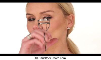 Close up Blond Woman Curling her Eyelashes