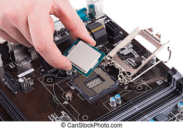 Black powerful motherboard with hand. Isolated on a white...