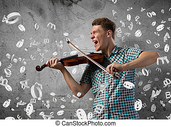 Musician playing violin - Young handsome guy playing violin...