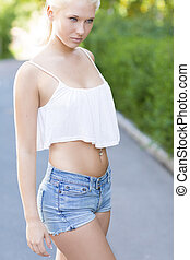 Attractive young woman standing in the street - Very...