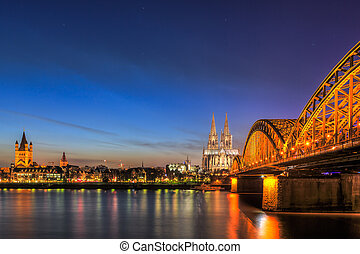 Cityscape of Cologne from the Rhine river at night time