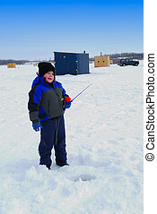 Boy Ice Fishing - A Young Boy Ice Fishing, Shacks in...