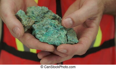 Miner Shows Copper Carbonate Ore - Anonymous male miner in...