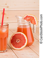 Pitcher full of grapefruit juice. - Close up of pitcher full...