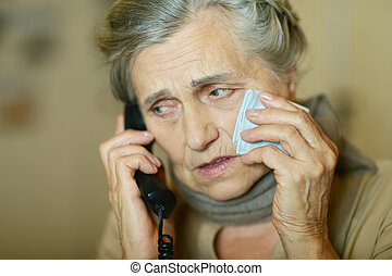 Senior woman calling - Portrait of a senior woman calling...