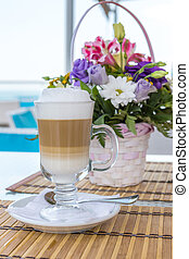 Latte in a glass with a blurred background of a beautiful...
