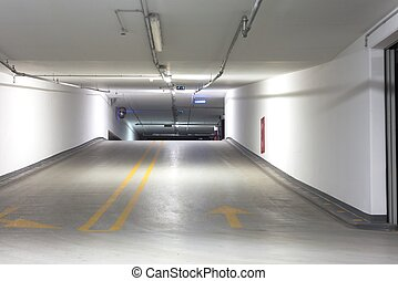 Empty underground parking lot area with lights