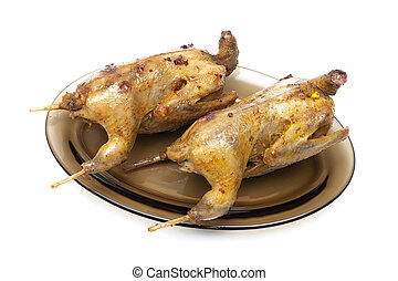 carcass roasted woodcocks on a plate isolated on white...
