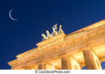 brandenburger tor by night with stars and moon