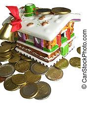 Christmas House - Money around a Christmas House, close up...