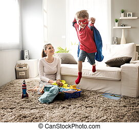 Little superhero helping his mother - Superhero boy and his...