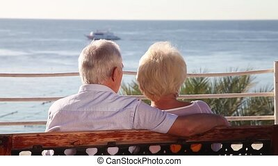 Senior couple relaxing on the bench - Senior couple enjoying...