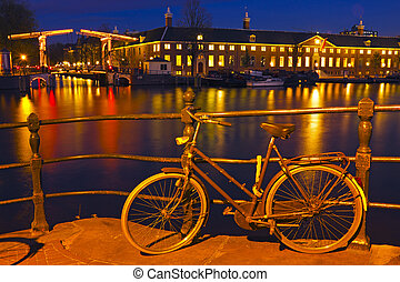 City scenic from Amsterdam in the Netherlands at the river...