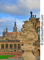 Closeup stone figure and Residenzschloss (city hall) on the...