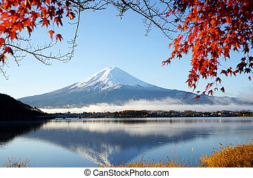 Mountain Fuji Kawaguchiko lake Japan with red maple leaf