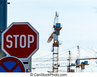 several construction cranes at construction site - at a...