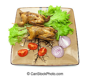 woodcocks fried with vegetables on a plate white background...