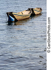 boat in a lake - an old wooden boat in a lake