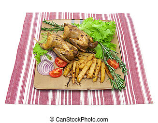 dish with fried woodcock and vegetables on a napkin on white...
