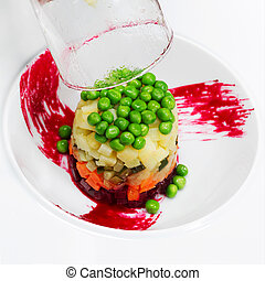 Preparation of salad of beets, potatoes, green peas and pickles,