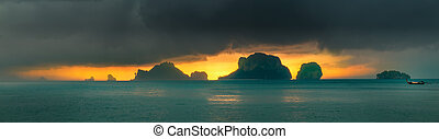 Dramatic sunset rays through a cloudy dark sky and mountains...