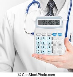 Doctor holdling in his hand calculator - medical aid concept...