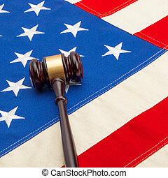 Wooden judge gavel over USA flag - court judgment concept