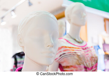 Mannequin faces - White mannequins in city mall