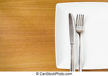 White place setting on a  wooden table