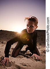 Beautiful woman in desert - Fashionable young attractive and...