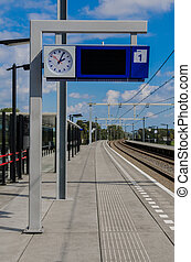 Train Information Post - A sign posts information about...