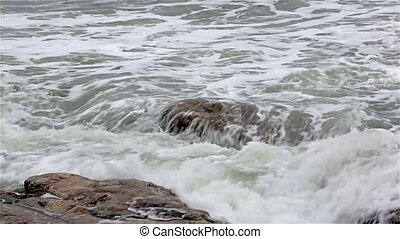 Ocean waves washing over rocks at Southwest Harbor, Maine