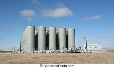 Fuel depot. Time lapse clouds. - Fuel depot in rural...