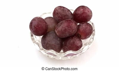 Grape falling from bowl