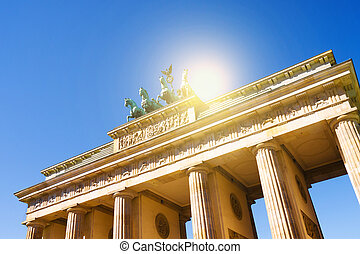 brandenburger tor in berlin with blue sky and the sun