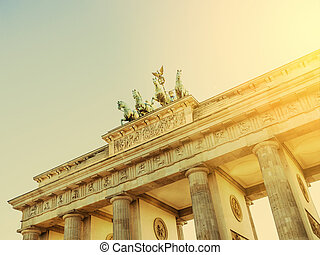 brandenburger tor in berlin with sunlight retro look