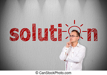 solution - businessman standing near a concrete wall with...