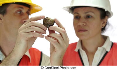 Miner Inspecting Copper Sulfide Ore - Short depth of field...