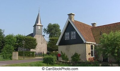 Sandfirden village and church on mound, FRIESLAND, THE...