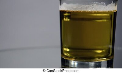 Vodka leaves from the glass with beer