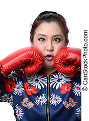 squint eyed crazy woman in boxing gloves