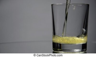 Beer is poured into a glass (rotating).