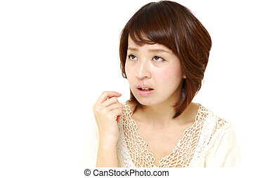 woman worries about something - concept shot of young...